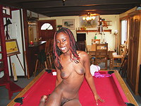 Ebony slut plays on billiard table