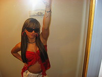 Cute Latin in sunglasses dancing on web