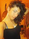 Stunning Latina posing nude in bed