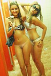 Young sexy teens in front of mirror