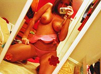 Self shot teen juices gathered into cup