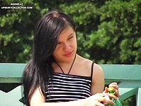 Aleona with naked pussy upskirt on a bench