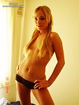 Sweet blonde wears nothing but small black shorts