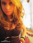 Slim blonde hottie shows her perky boobs