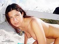 Brunette posing on beach