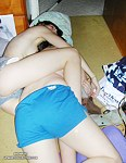 Two sexy babes wrestle in short shorts