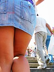Girls jeans up skirt in closeup