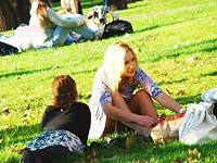 Blonde in park hiding upskirt