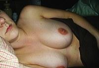 Between her tits
