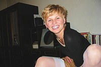 Short-haired blonde poses on video