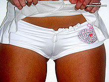 Sweetie parades her camel toe pussy