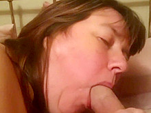 My slutty neighbour sucks my cock on her bed.